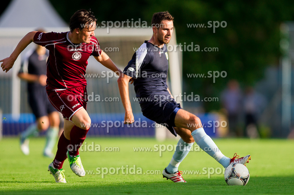 Tilen Klemencic of Triglav vs Josip Tadic of Rijeka during Friendly football match between NK Triglav and HNK Rijeka on June 25, 2013 in Sports park Kranj, Slovenia. (Photo by Vid Ponikvar / Sportida.com)