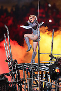 American singer, songwriter, actress and record producer Lady Gaga touches down on an elevated platform as she performs at halftime of the Atlanta Falcons Super Bowl LI football game against the New England Patriots on Sunday, Feb. 5, 2017 in Houston. The Patriots won the game 34-28 in overtime. (©Paul Anthony Spinelli)