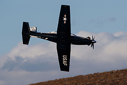 Beechcraft T-6 Texan II from United States Air Force 80th Flying Training Wing, Sheppard Air Force Base, Texas, flies low level through the Jedi Transition, Star Wars Canyon, Death Valley National Park, California, United States of America
