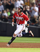 ATLANTA, GA - JUNE 08:  Third baseman Martin Prado #14 of the Atlanta Braves runs to second base during the game against the Toronto Blue Jays at Turner Field on June 8, 2012 in Atlanta, Georgia.  (Photo by Mike Zarrilli/Getty Images)