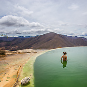 Bathing in the natural limestone pools in Hierve El Agua, Mexico.