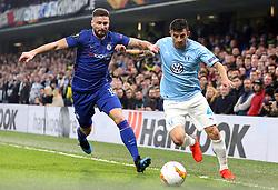 Chelsea's Olivier Giroud (left) and Malmo's Behrang Safari battle for the ball