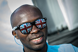 A man wearing novelty sunglasses at the Brownstock Festival in Essex.