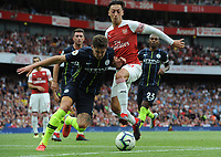 Football - 2018 / 2019 Premier League - Arsenal vs. Manchester City<br /> <br /> Mesut Ozil of Arsenal and John Stones of Man City, at The Emirates.<br /> <br /> COLORSPORT/ANDREW COWIE