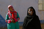 Two Nubian women in a village on the west bank of the river Nila at Aswan in Upper Egypt