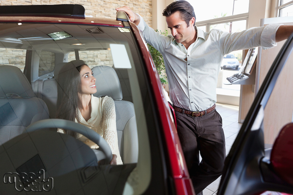 Couple talking in car show room