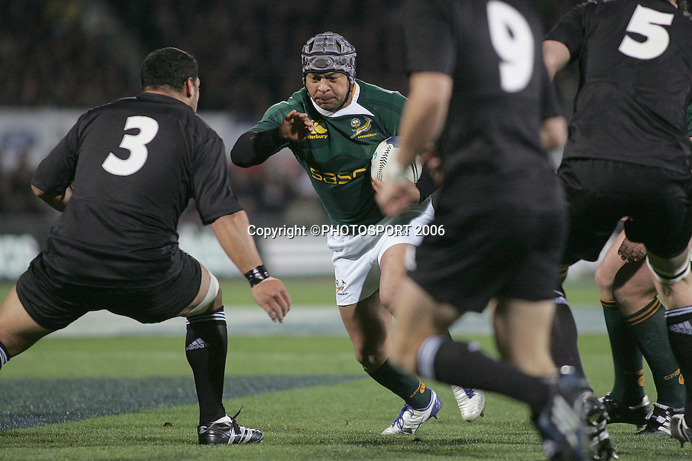 Adrian Jacobs of South Africa looks for a way past  John Afoa during the Philips Tri Nations, Test match, All Blacks v South Africa, Carisbrook, Dunedin, New Zealand, Saturday 12 July 2008. South Africa won 30 - 28. Photo: Jeff Brass/PHOTOSPORT