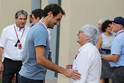 Grand Prix von Abu Dhabi auf dem Yas Marina Circuit / 271116<br /> <br /> ***(L to R): Roger Federer (SUI) Tennis Player with Bernie Ecclestone (GBR).<br /> 27.11.2016. Formula 1 World Championship, Rd 21, Abu Dhabi Grand Prix, Yas Marina Circuit, Abu Dhabi, Race Day.<br /> ***