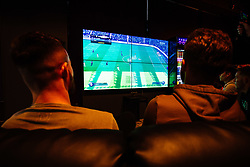 Bailey Wright and Matty Taylor in action as Bristol City players visit the Belong by GAME gaming arena to play the new FIFA 18 - Rogan/JMP - 27/09/2017 - Merchant Street - Bristol, England.