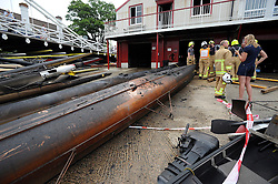 © licensed to London News Pictures. MARLOW, UK.  03/08/11. Damaged boats lie outside the club after being removed during the fire. Marlow Rowing Club has been badly damaged by fire today (03 August 2011). Boats with an estimated value of 100,000 pounds have been damaged. Steve Redgrave, Olympic Rower, who trained at the club and is from Marlow said his daughters boat is believed to be inside.  Mandatory Credit Stephen Simpson/LNP