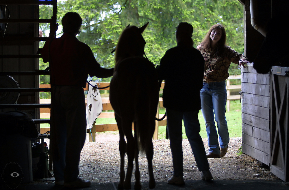 Berit McClure (right) takes a Vocation Vacation to learn horse training at the Four Mountains Ranch northwest of Portland. Owners Rich Ovenburg (left) and Mary Folberg (center) work many horses on a beautiful piece of land overlooking the confluence of the Willamette and Columbia rivers.
