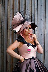 LIVERPOOL, ENGLAND - Thursday, April 6, 2017: Leanne Phillips, 34 from Liverpool, wearing Leanne Alexandra and a self-made hat, drinking a Cosmopolitan Cocktail, during The Opening Day on Day One of the Aintree Grand National Festival 2017 at Aintree Racecourse. (Pic by David Rawcliffe/Propaganda)