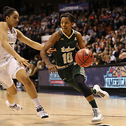 Courtney Williams, USF, drives past Gabby Williams, UConn, during the UConn Huskies Vs USF Bulls Basketball Final game at the American Athletic Conference Women's College Basketball Championships 2015 at Mohegan Sun Arena, Uncasville, Connecticut, USA. 9th March 2015. Photo Tim Clayton