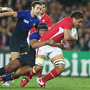 Toby Faletau, Wales, is tackled by Thierry Dusautoir, France, during the Wales V France Semi Final match at the IRB Rugby World Cup tournament, Eden Park, Auckland, New Zealand, 15th October 2011. Photo Tim Clayton...