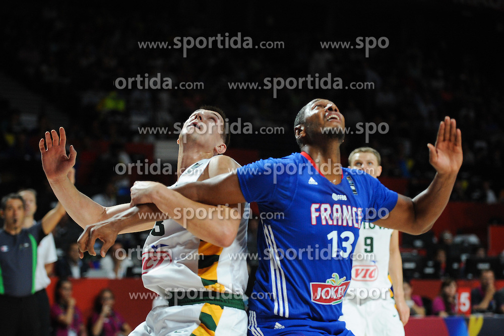 Paulius Jankunas of Lithuania vs Boris Diaw of France in action during the 2014 FIBA World Basketball Championship Third Place match between France and Lithuania at the Palacio de los Deportes, on September 13, 2014 in Madrid, Spain. Photo by Tom Luksys  / Sportida.com <br /> ONLY FOR Slovenia, France