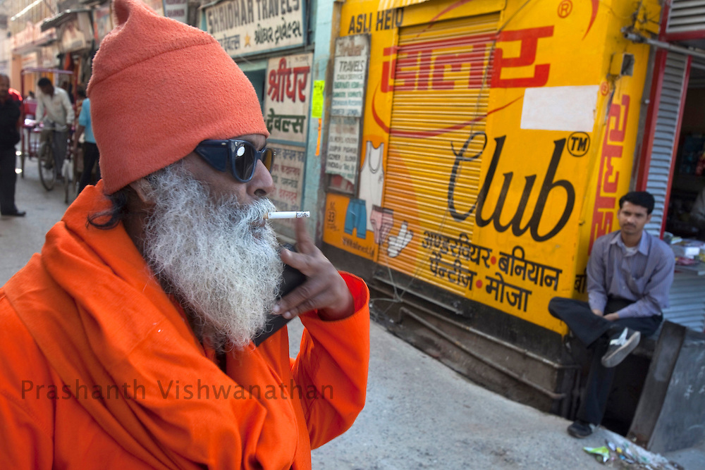 A holy man smokes infront of a lane during he Maha Kumbh ceremony in Haridwar, February 11, 2010.  Photographer:Prashanth Vishwanathan