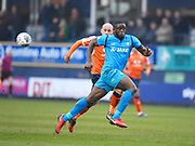 Barnet player John Akinde runs onto a the ball in the first half during the EFL Sky Bet League 2 match between Luton Town and Barnet at Kenilworth Road, Luton, England on 24 March 2018. Picture by Ian  Muir.during the EFL Sky Bet League 2 match between Luton Town and Barnet at Kenilworth Road, Luton, England on 24 March 2018. Picture by Ian  Muir.