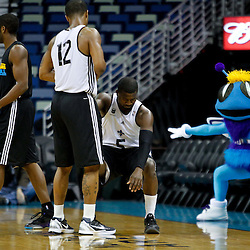 December 17, 2011; New Orleans, LA, USA; New Orleans Hornets point guard Justin Dentmon (5) is helped out by teammate Trey Johnson (12) as Hornets mascot Hugo reacts during a scrimmage at the New Orleans Arena.   Mandatory Credit: Derick E. Hingle-US PRESSWIRE
