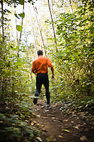 A man trail running on the Little Si Trail near North Bend, Washington, USA.  Blurred.