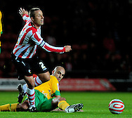 Southampton - Tuesday, September 30th, 2008: Chris Perry  of Southampton is tackled by Antoine Sibierski  of Norwich City during the Coca Cola Championship match at Southampton. (Pic by Daniel Hambury/Focus Images)