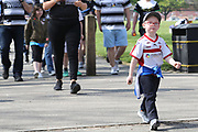 A young Hull Kingston Rovers supporter marches towards the stadium in front of the Black and White Army the Betfred Super League match between Hull FC and Hull Kingston Rovers at Kingston Communications Stadium, Hull, United Kingdom on 19 April 2019.