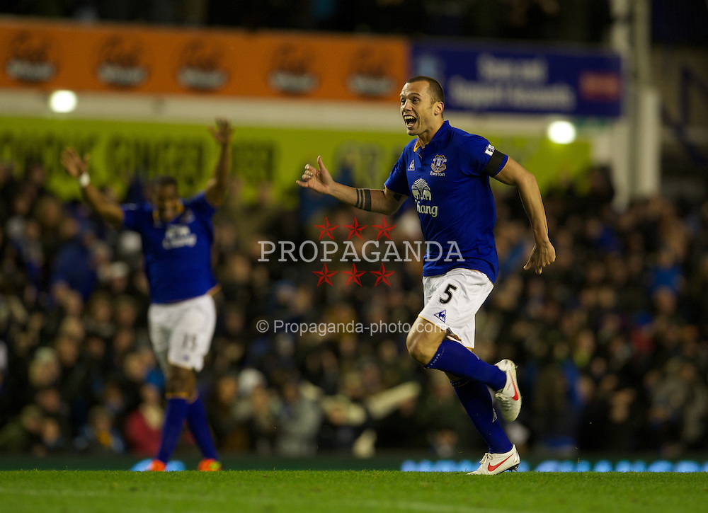 LIVERPOOL, ENGLAND - Wednesday, January 4, 2012: Everton's John Heitinga celebrates his side's first goal against Bolton Wanderers during the Premiership match at Goodison Park. (Pic by David Rawcliffe/Propaganda)