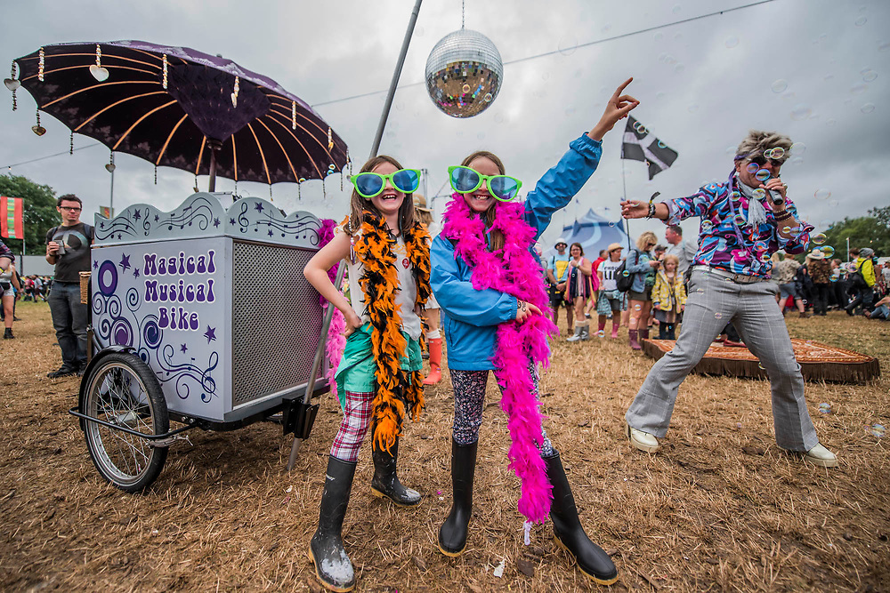 Children dance at the disco bubble mans tricycle - Many weird activities in teh circus field - The 2017 Glastonbury Festival, Worthy Farm. Glastonbury, 24 June 2017