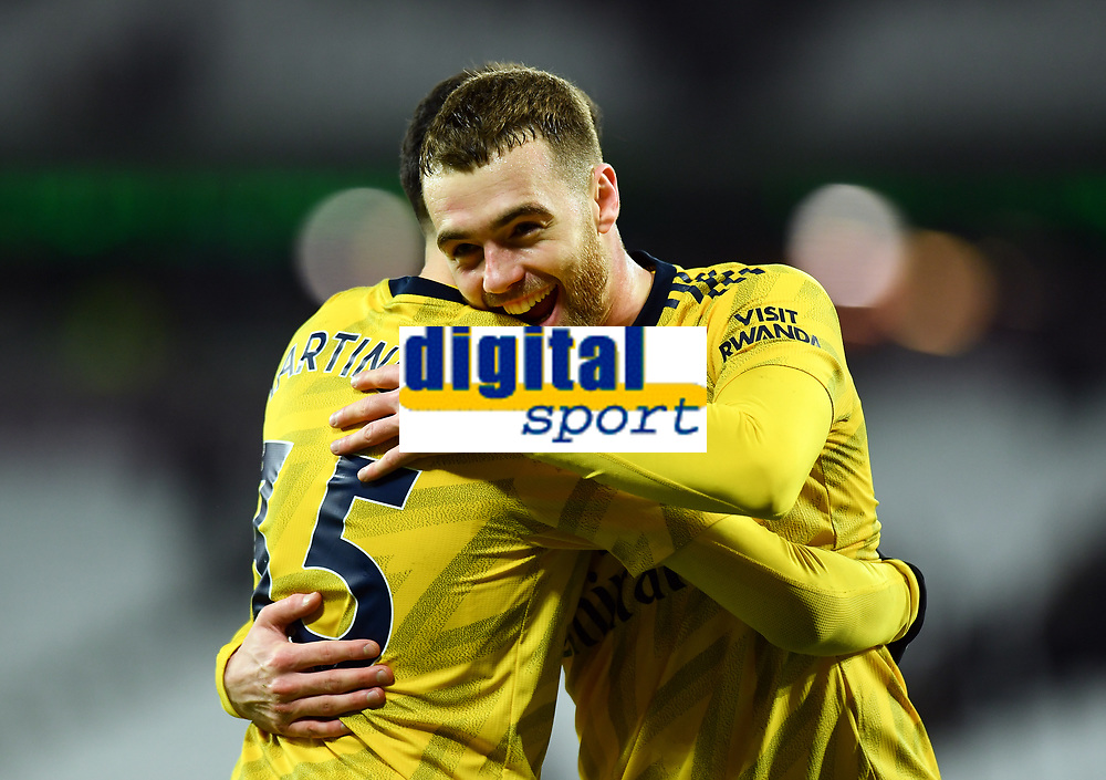 Football - 2019 / 2020 Premier League - West Ham United vs. Arsenal<br /> <br /> Arsenal's Calum Chambers with Gabriel Martinelli after their 3-1 victory, at The London Stadium.<br /> <br /> COLORSPORT/ASHLEY WESTERN