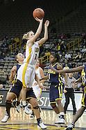 08 February 2007: Iowa guard Kristi Smith (11) shoots in Iowa's 66-49 win over Michigan at Carver-Hawkeye Arena in Iowa City, Iowa on February 8, 2007.