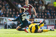 Mike Petrasso of Queens Park Rangers goes down under a challenge from Burnley goalkeeper Thomas Heaton during the Sky Bet Championship match at Turf Moor, Burnley<br /> Picture by Matt Wilkinson/Focus Images Ltd 07814 960751<br /> 02/05/2016