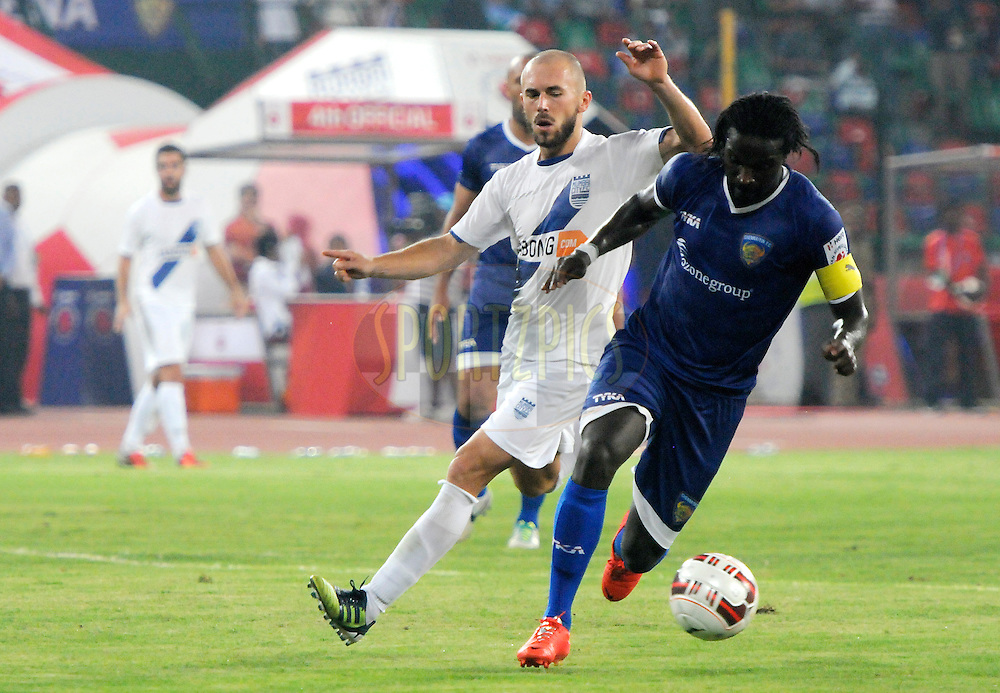 Bernard Mendy of Chennaiyin FC and Jan Stohanzl of Mumbai City FC during match 15 of the Hero Indian Super League between Chennaiyin FC and Mumbai City FC held at the Jawaharlal Nehru Stadium, Chennai, India on the 28th October 2014.<br /> <br /> Photo by:  Pal Pillai/ ISL/ SPORTZPICS