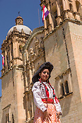 Traditional costumed Zapotec maiden outside the Santo Domingo church during the Day of the Dead Festival known in spanish as Día de Muertos on October 26, 2014 in Oaxaca, Mexico.