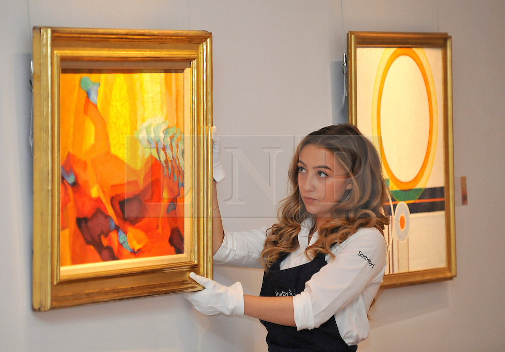 © licensed to London News Pictures. LONDON, UK.  09/06/11. An assistant holds Frantisek Kupka's 'Movement' estimated to fetch £500,000-700,000.  Press preview for Sotheby's upcoming Sale of The Hascoe Family Collection of Important Czech Art. Highlights include a group of 20 paintings from Frantisek Kupka, including Movement, which is estimated to fetch £500,000 to £700,000 and Bohumil Kubi?ta's Still Life with Fruit of 1909, estimated at £300,000 to £500,000.  Photo credit should read Stephen Simpson/LNP
