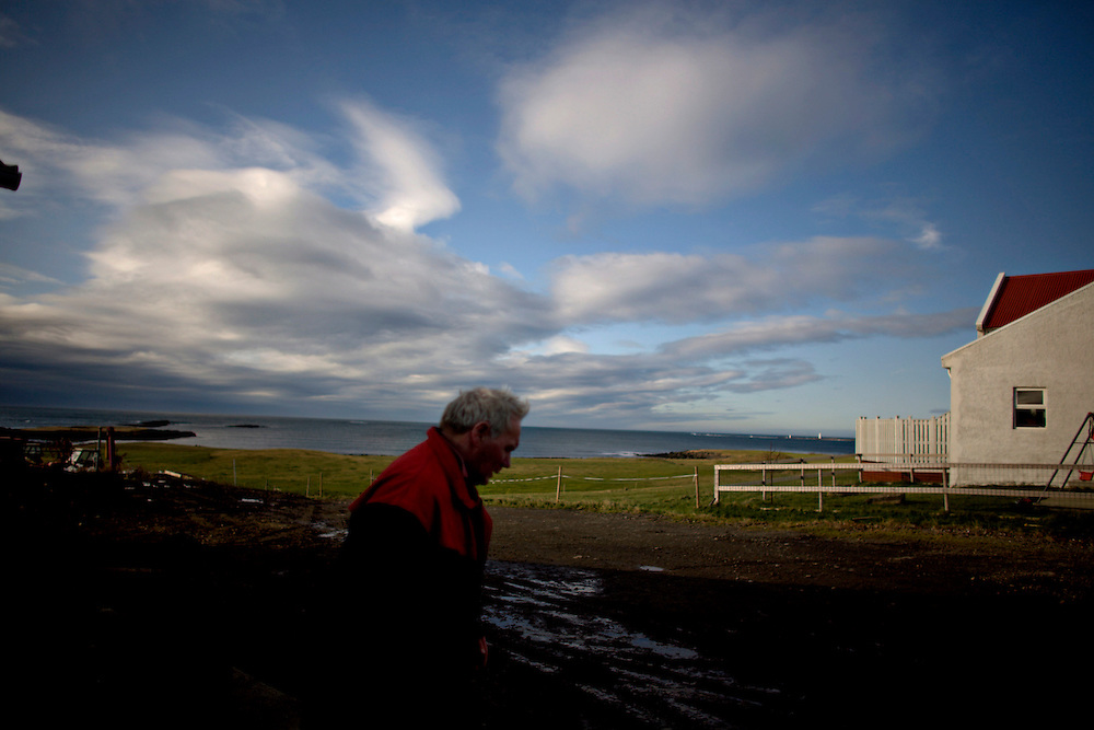 "Iceland crisis, October 10, 2008..Anton Ottesen on the family farm in Akranes, Iceland. The Ottesen-family has lived on this land for 149 years and are not to worry even if they lost a good amount of savings when Landsbankinn fell.  ""I don't feel sorry for the ones over there"" Daniel says and point towards Reykjavik visible across the sea on the horizon...As of Thursday October 9th, the three largest banks in Iceland had been taken over by the Icelandic government. This makes Iceland the hardest hit European country of the global financial crisis of autumn 2008 effectively putting the country by some measure in an economic depression."