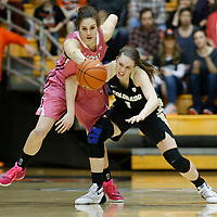 Oregon State's Samantha Siegner, left, steals the ball from Colorado's Makenzie Ellis in the first half of an NCAA college basketball game in Corvallis, Ore., on Friday, Feb. 12, 2016. (AP Photo/Timothy J. Gonzalez)