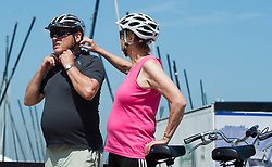 Tourists from Germany enjoy a Boat and Bike tour through Flanders. Tour members prepare to depart Knokke, on the Belgian coast, for Sluis, the Netherlands,  on Sunday, July 11, 2010. (Photo © Jock Fistick)