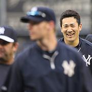 Masahiro Tanaka, New York Yankees, shares a joke with team mates during batting practice before the New York Yankees V New York Mets, Subway Series game at Yankee Stadium, The Bronx, New York. 12th May 2014. Photo Tim Clayton