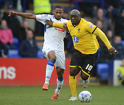 Tranmere Rovers's James Rowe competes with Wimbledon's Adebayo Akinfenwa - Photo mandatory by-line: Richard Martin-Roberts/JMP - Mobile: 07966 386802 - 28/03/2015 - SPORT - Football - Birkenhead - Prenton Park - Tranmere Rovers v AFC Wimbledon - Sky Bet League Two