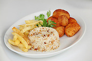 A plate of carbohydrates with baked potato rice and french fries