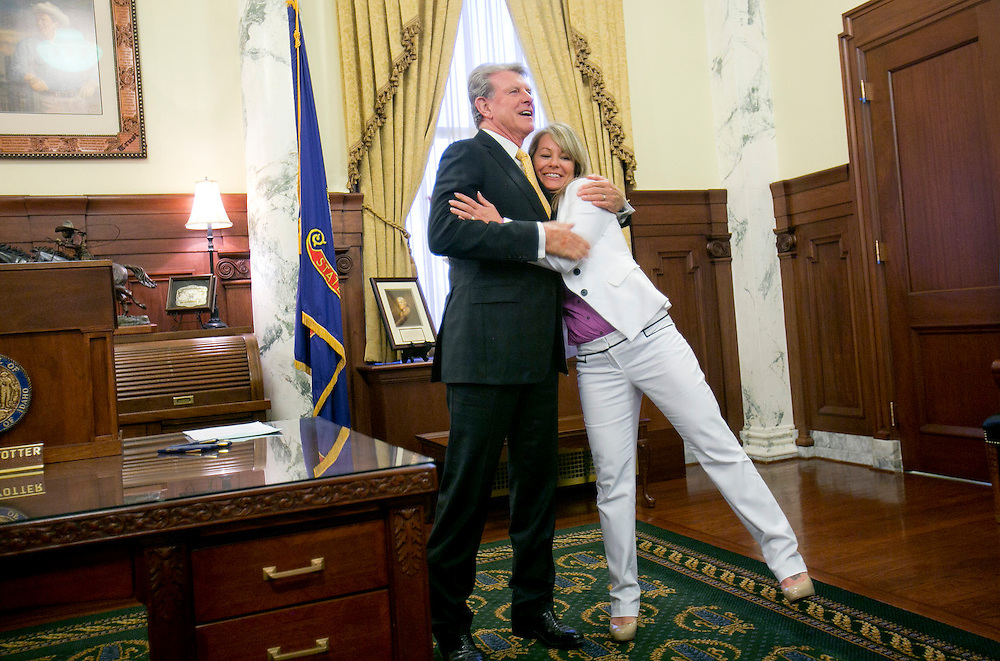 """Idaho Governor Butch Otter hugs Idaho Superintendent of Public Instruction Sherri Ybarra before a public signing of House Bill 296 in the Governor's Ceremonial Office at the Idaho State Capitol. House Bill 296 is described by the Governor's office as """"legislation phasing in a """"Career Ladder"""" for accountably increasing compensation for Idaho public school teachers over five years"""". Thursday April 2, 2015"""