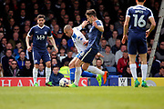 Bury attacker James Vaughan (12) battles for possession with Southend United defender Ryan Leonard (18) during the EFL Sky Bet League 1 match between Southend United and Bury at Roots Hall, Southend, England on 30 April 2017. Photo by Matthew Redman.