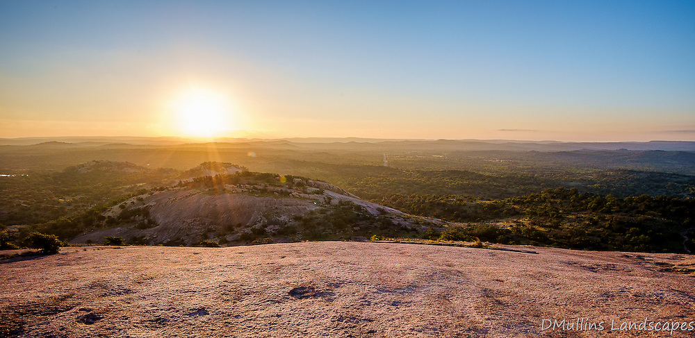 Sunrise viewed from the top of Enchanted rock.<br /> <br /> Available Sizes: 9x19, 18x36, Tri-Print (see Prints tab)