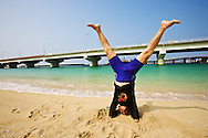 Fumiyasu Yamakawa, begins his exercise regimen every day at 6 a.m. on a beach in Naha, Okinawa. He stretches, runs, swims, and does yoga, which includes standing on his head. After each workout, Fumiyasu lies on the sand to silently thank each part of his body for working properly. He claims that ten minutes of meditation is equivalent to three hours of sleep.<br />