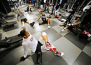 Maya Moore, bottom left, stretches with teammates in the rides the team's weight room at the University of Connecticut in Storrs, Conn., Thursday, March 3, 2011  (AP Photo/Jessica Hill)
