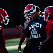 August 31, 2009 - Marble Hill, New York : The John F. Kennedy High School Knights varsity football team spent Monday conditioning, watching tapes, and running drills in preparation for their 2009 season.  Assistant  coach Ivan Rosario talks with players during practice.