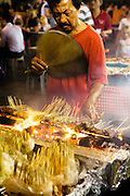 Traditional satay vendor at Lau Pa Sat Festival Pavillion food center