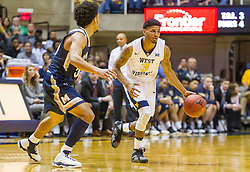 Nov 11, 2016; Morgantown, WV, USA; West Virginia Mountaineers guard James Bolden (3) dribbles the ball during the second half against the Mount St. Mary's Mountaineers at WVU Coliseum. Mandatory Credit: Ben Queen-USA TODAY Sports