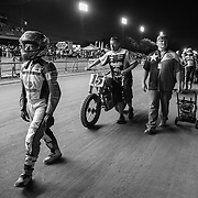 Riders and crew are paraded to the start grid in front of a packed grandstand in Sacramento.
