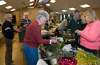 Beverly Clarenbach, Eleaner Swain and Eileen Russilillo make centerpieces with the Opechee Garden Club at Weirs Community Center on Tuesday.  (Karen Bobotas/for the Laconia Daily Sun)