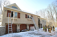 NEW HOPE, PA - FEBRUARY 18: Firefighters survey the damage at a home which caught fire February 18, 2015 in New Hope, Pennsylvania. (Photo by William Thomas Cain/Cain Images)